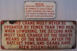 2 x enamel notice signs. THIS CRANE MUST NEVER BE OPERATED BY FEWER THAN TWO MEN together with a
