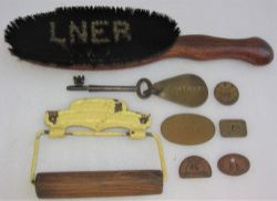 A sundry Lot consisting of an LNER Clothes brush. A Great Western Railway Toilet holder. A