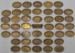 42 brass SOUTHERN RAILWAY Paychecks together with a brass STATION MASTER cap badge.