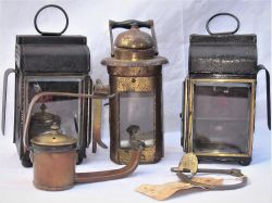 A lot to include a brass clasp with lock and 4 miscellaneous oil lamps. Two right and left hand cart