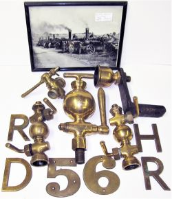 A collection of traction engine parts to include brass lubricators, taps and brass letters. Also