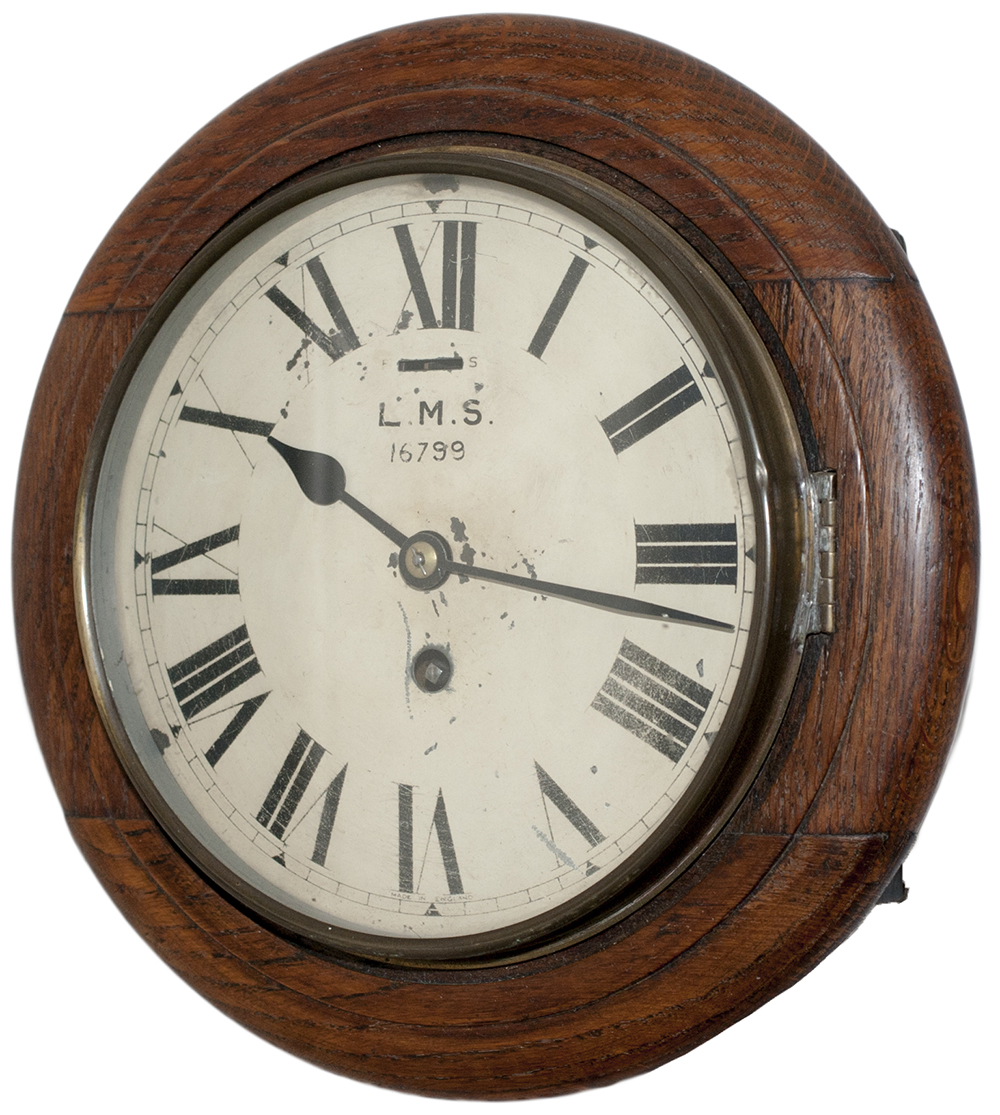 Lot 409 - LMS 8 inch oak cased railway clock with a Smiths Empire going barrel movement. The original dial