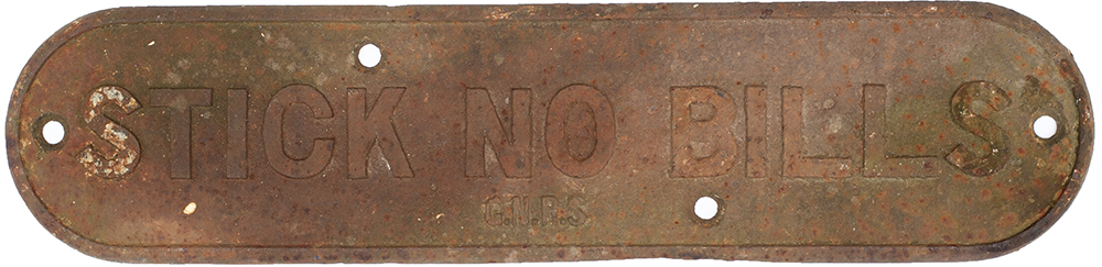 Lot 39 - GNR cast iron doorplate STICK NO BILLS. With G.N.R.S. cast into the face and in lightly cleaned