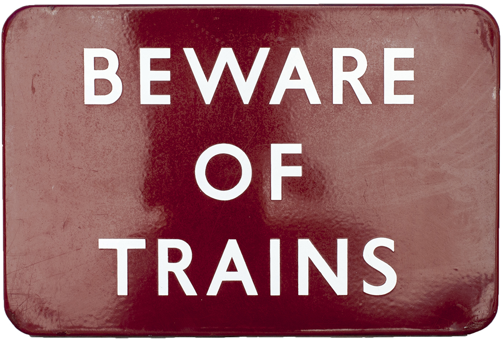 Lot 52 - BR(M) FF enamel sign BEWARE OF TRAINS measuring 18in x 12in. In very good condition with a couple of