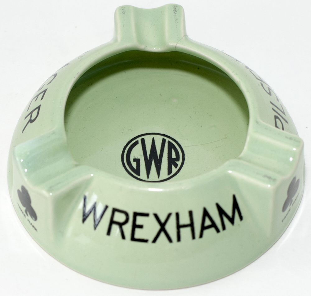 Lot 81 - GWR china Ashtray marked with the GWR roundel in the centre and WREXHAM PILSENER LAGER. Base is