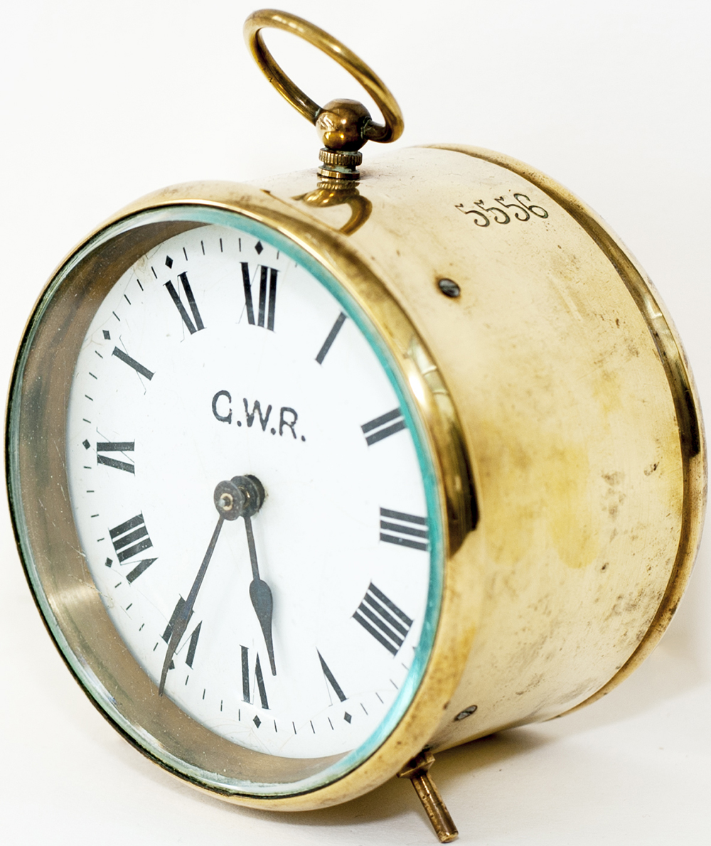 Lot 431 - GWR brass Drum Clock with original enamel dial lettered G.W.R. and stamped 5556 on the side and back