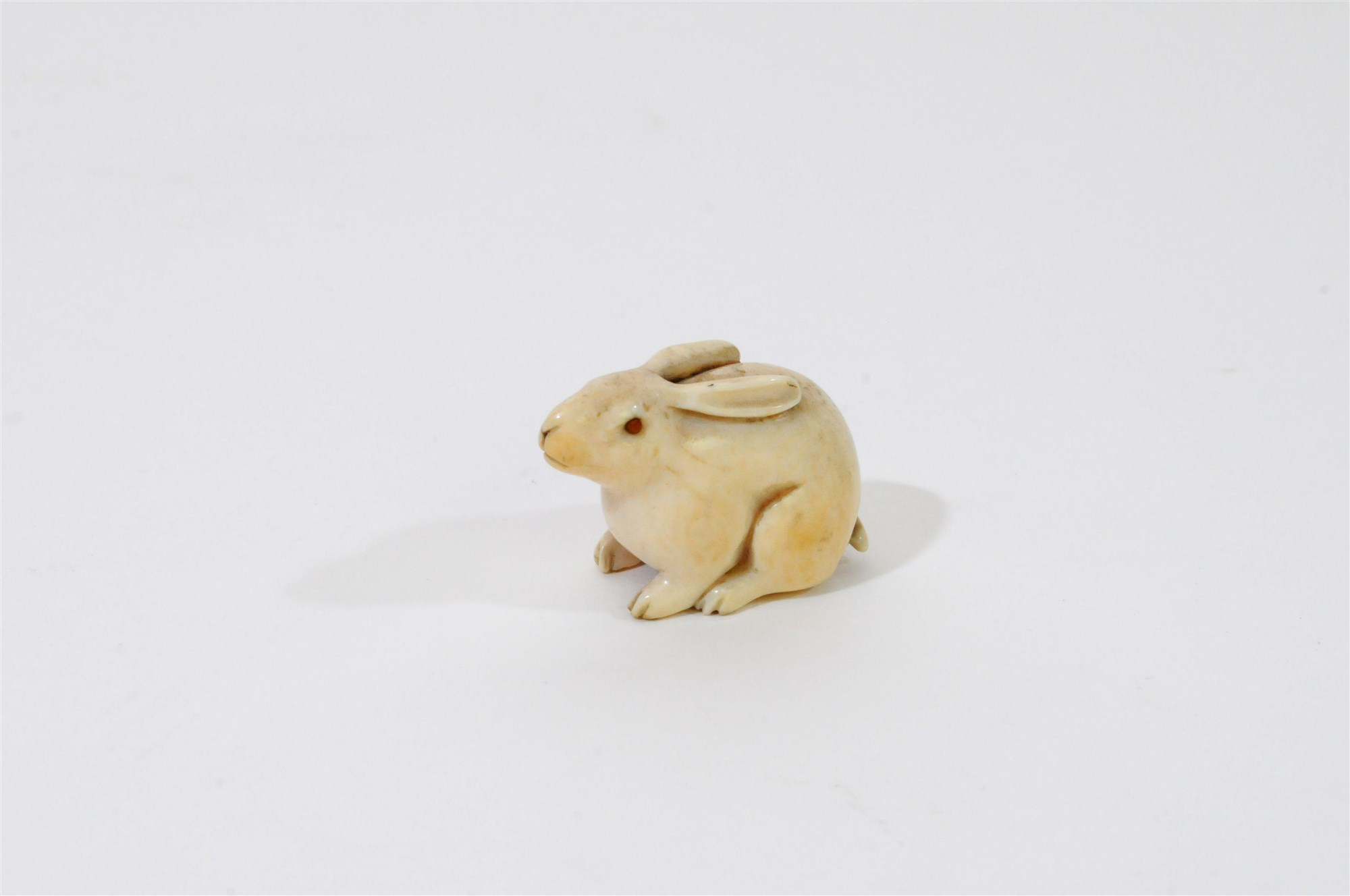 A Japanese carved ivory study of the lunar hare