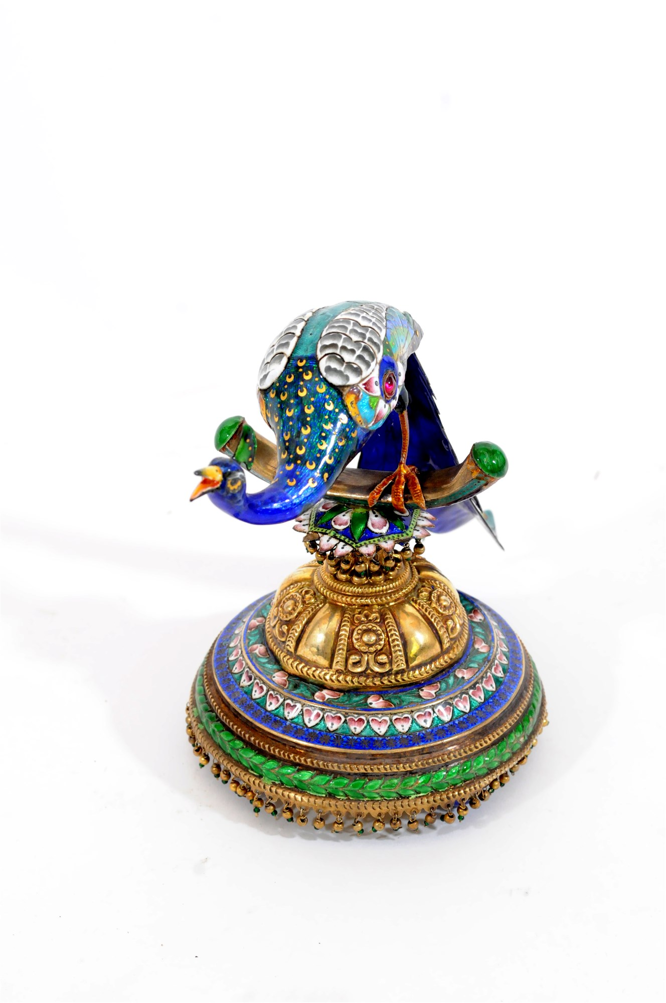 Lot 276 - An Indian parcel gilt and silver enamelled peacock