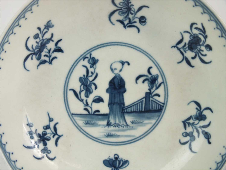 Lot 10 - A Worcester porcelain 'Waiting Chinaman' tea bowl and saucer