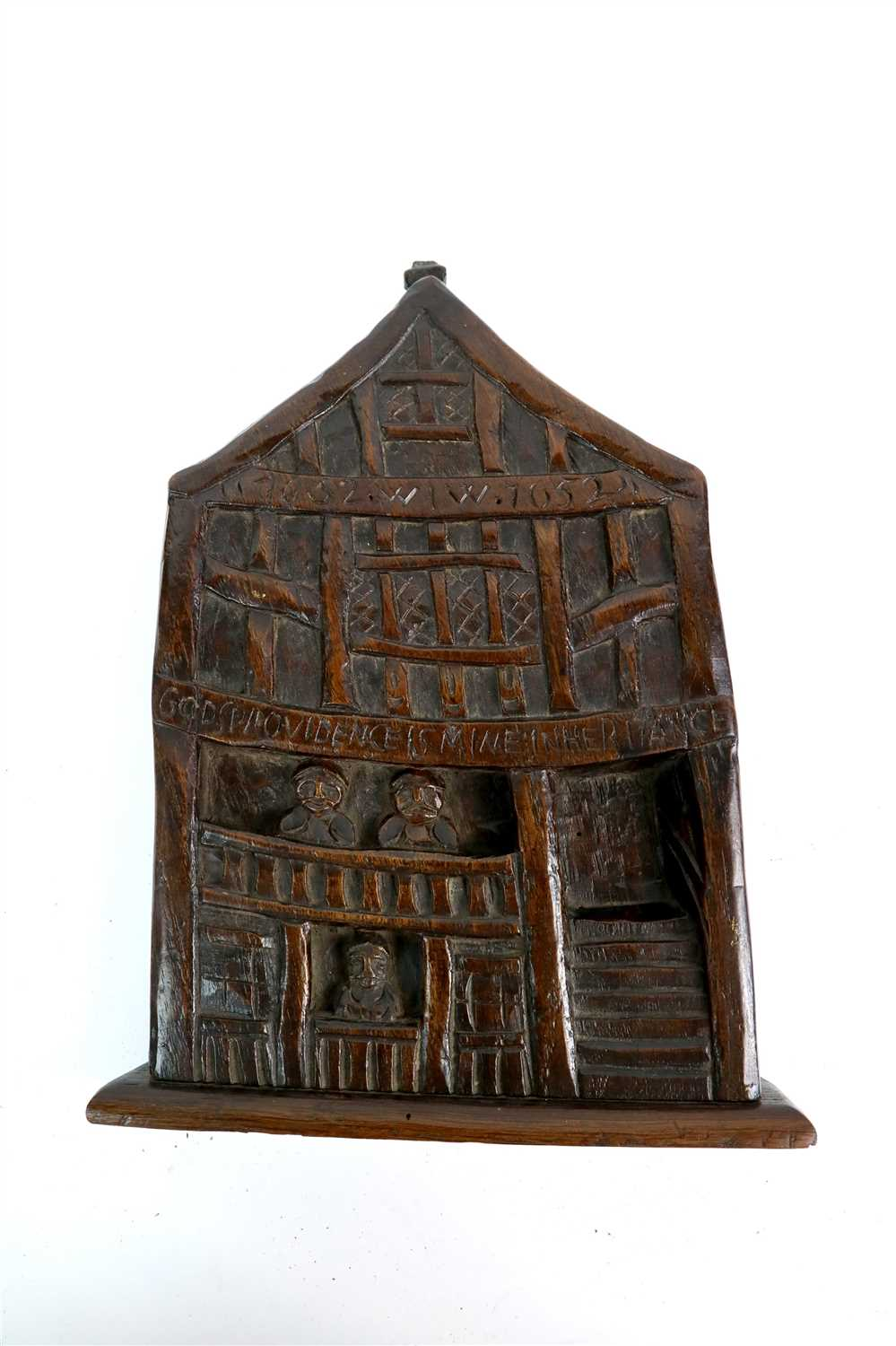 Lot 179 - A 17th century carved vernacular oak panel portraying God's Providence House, Chester