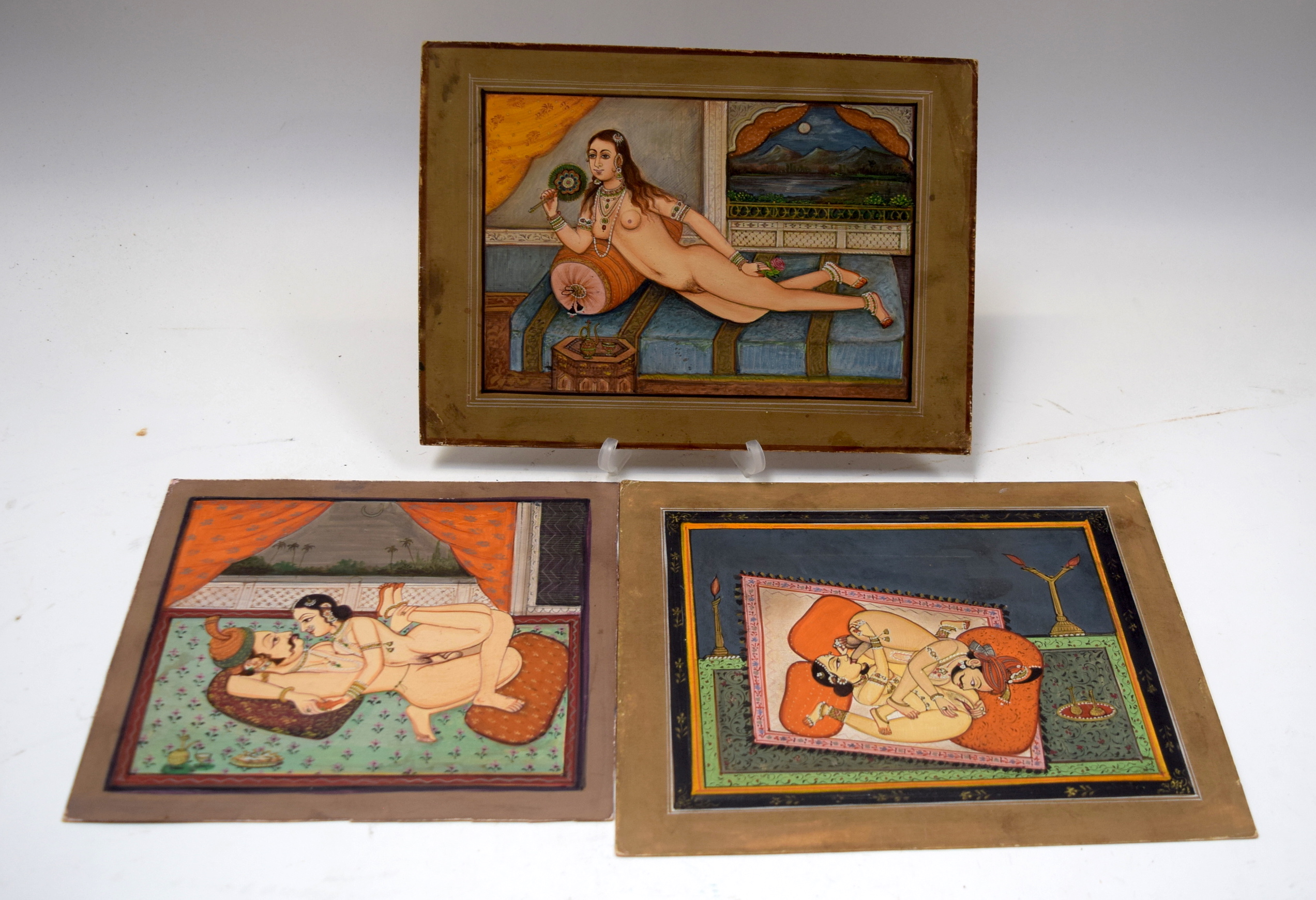 Lot 2949 - INDIAN SCHOOL (Early 20th century) UNFRAMED SET OF THREE EROTIC GOUACHE ON CARD, depicting figures