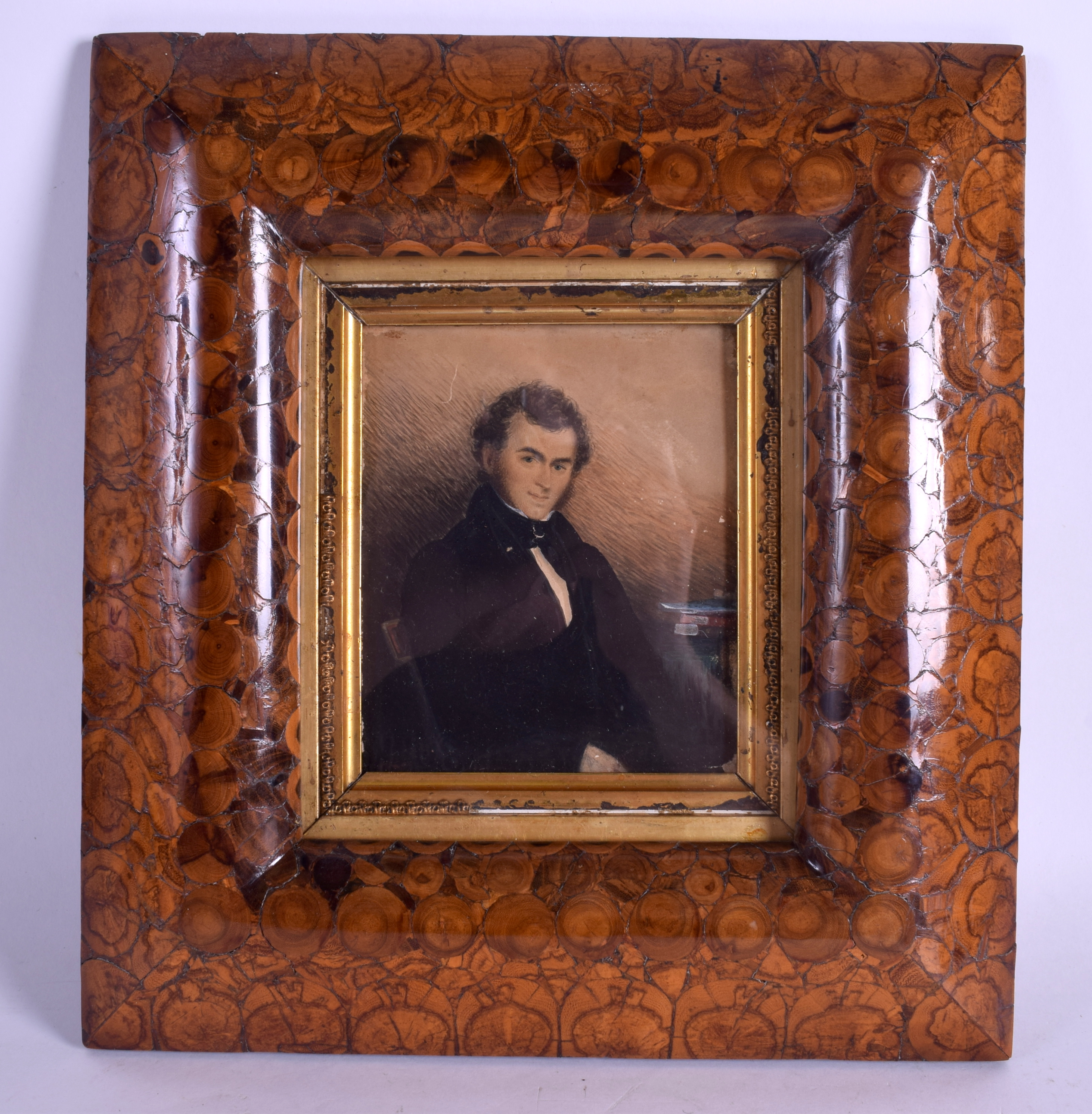 Lot 321 - A QUEEN ANNE OYSTER WOOD FRAME containing a late Regency watercolour of a gentleman. Frame 30 cm x