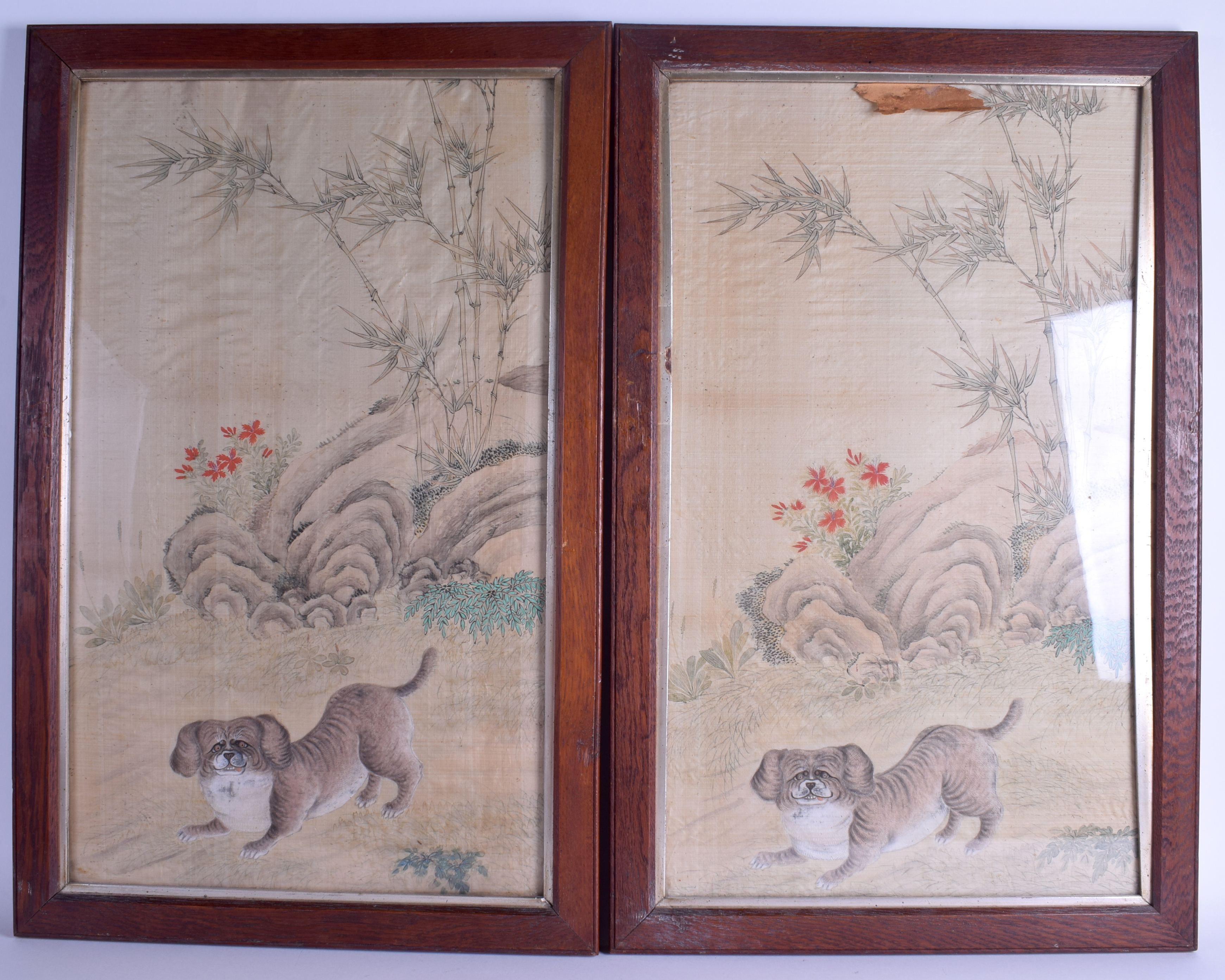 Lot 1517 - A PAIR OF 19TH CENTURY CHINESE FRAMED WATERCOLOURS depicting a roaming hound within a landscape. 63