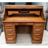 Lot 731 - Oak roll topped desk with fitted interior.