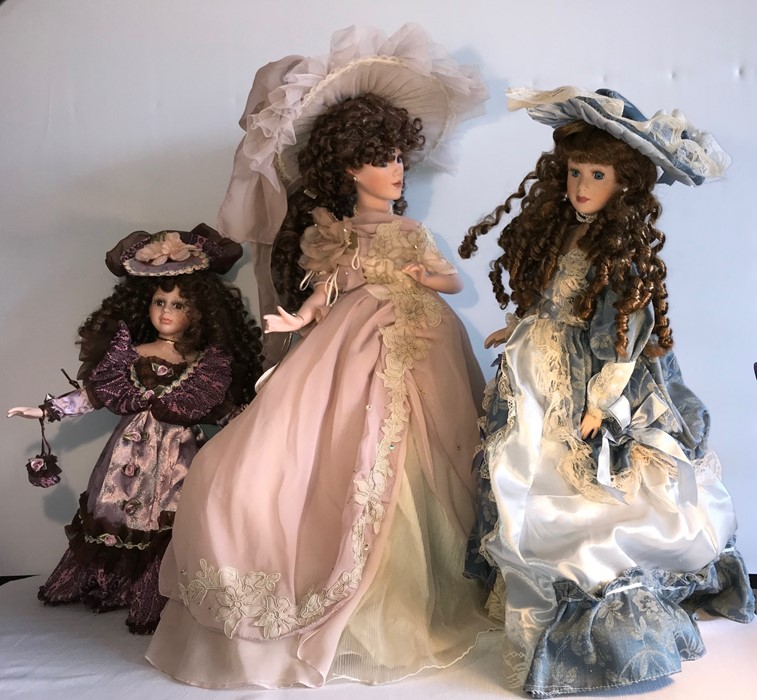 Lot 5 - Three good quality modern porcelain headed dolls including Leonardos collectors doll. H-62cms