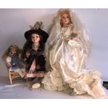 Lot 4 - Three good quality porcelain headed dolls including one hand painted Knightbridge collection. H -