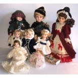 Lot 6 - Eight good quality modern porcelain headed dolls and a rag doll including one by Maureen Thomas,