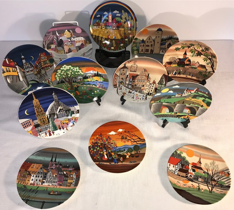 Lot 29 - A collection of Poole England pottery plates with many scenes. Spring, Summer, Autumn, Winter and
