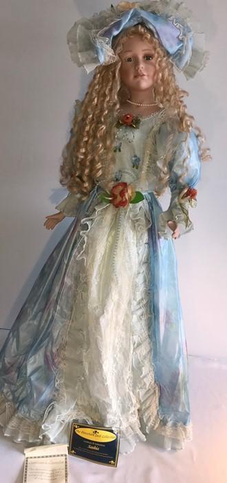 Lot 11 - A good quality modern porcelain headed dolls, Saskia 1352 of 3000 - H - 98cms.
