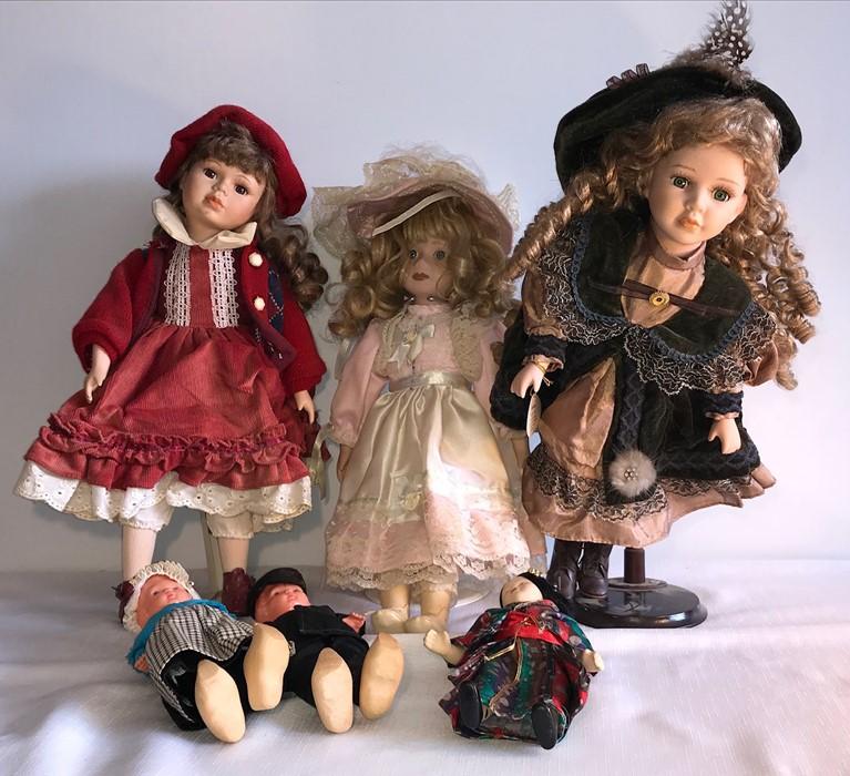 Lot 16 - Six good quality modern porcelain headed dolls.