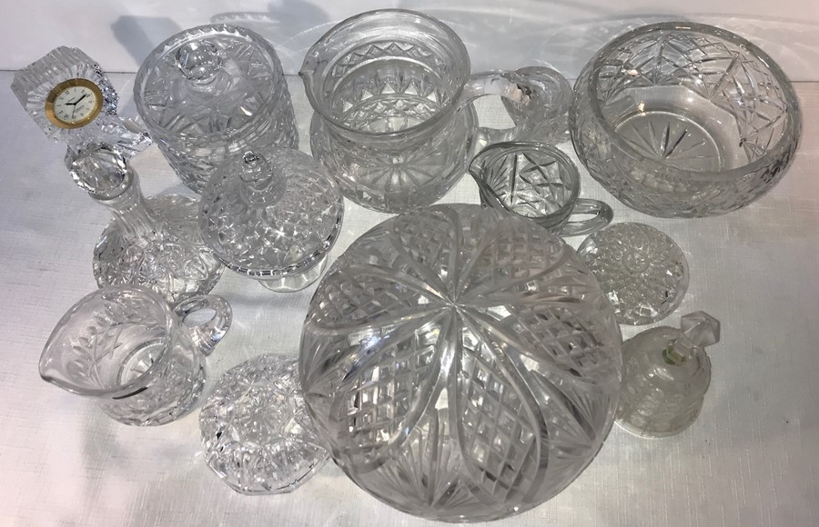 Lot 54 - A quantity of cut and moulded glass including clock, bell, bowl, jug, lamp shade etc.