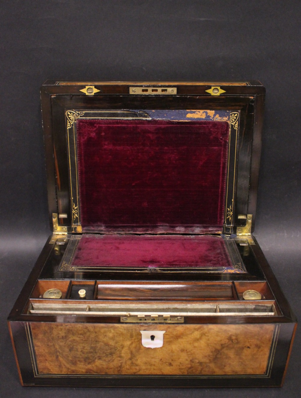Lot 149 - A WALNUT & EBONISED INLAID WORK BOX with mother of pearl cartouche and keyplate, opens to reveal
