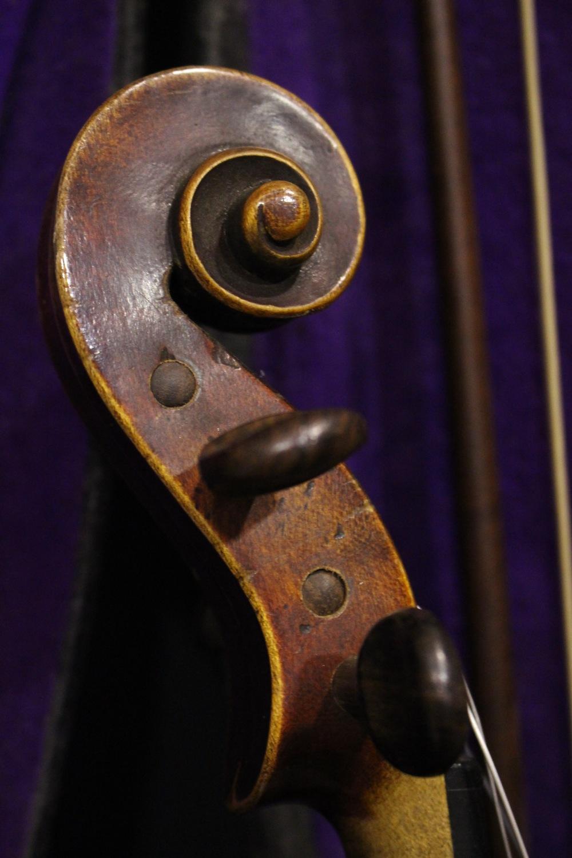 "Lot 330 - A CASED VIOLIN, with bow, baring label within, ""Antonius Stradivarius Cremonent, AS, Faciebat Anno"