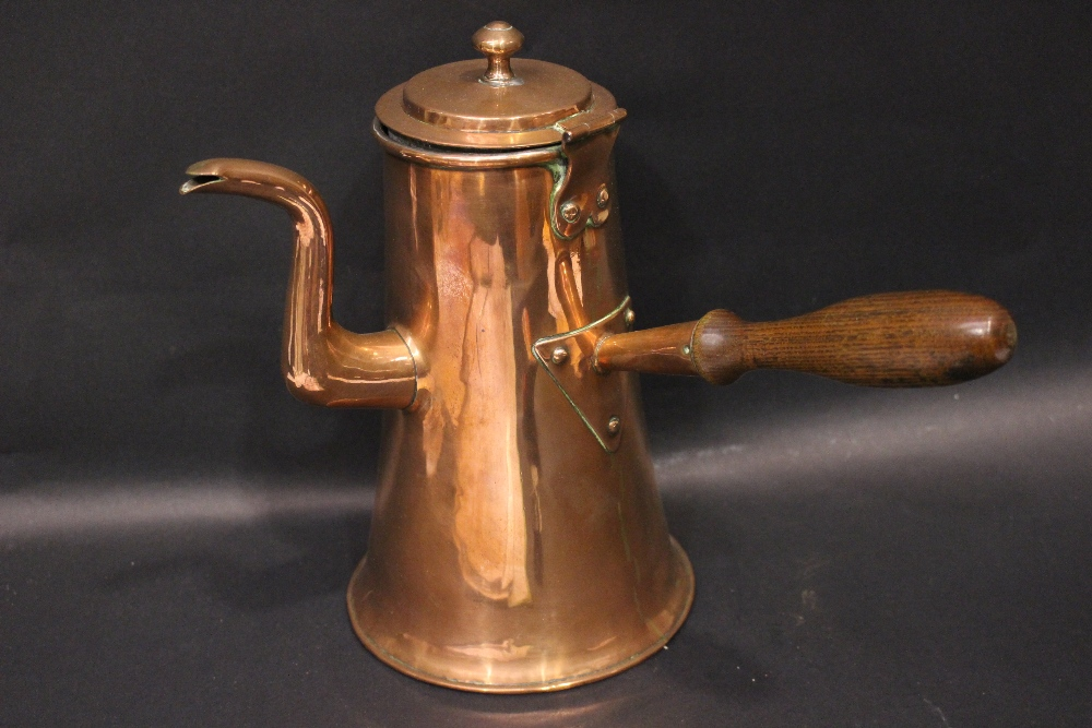 "Lot 324 - A COPPERWARE KETTLE, with hinged lid, and turned wooden handle, 11.25"" tall approx"