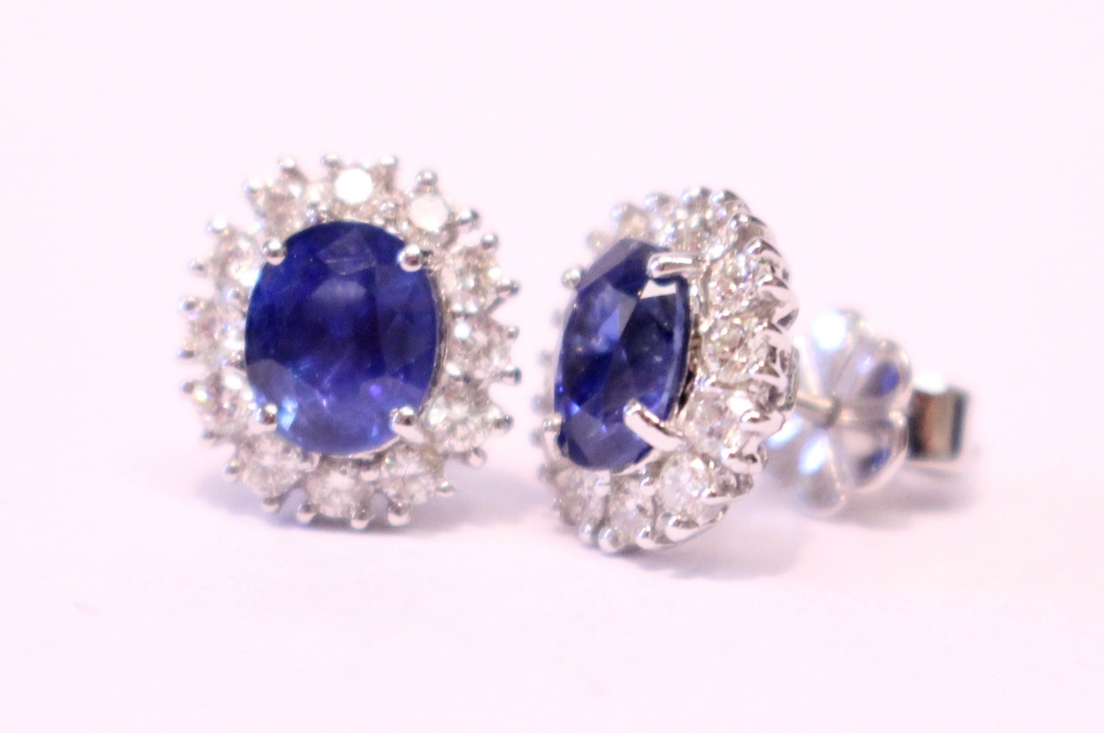Lot 20 - A PAIR OF 18CT WHITE GOLD, SAPPHIRE & DIAMOND CLUSTER EARRINGS, 2.20ct sapphire, 1.40cts diamond