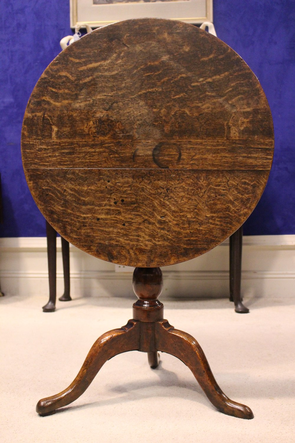 Lot 43 - AN 18TH CENTURY TIP UP CENTRE TABLE, with oak top and fruit wood base, a column support on a