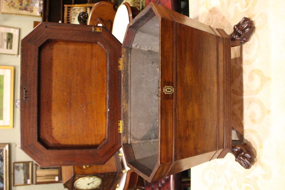 Lot 23 - A FINE IRISH GEORGIAN MAHOGANY WINE COOLER / CELLARET raised on lion paw feet, original gilded