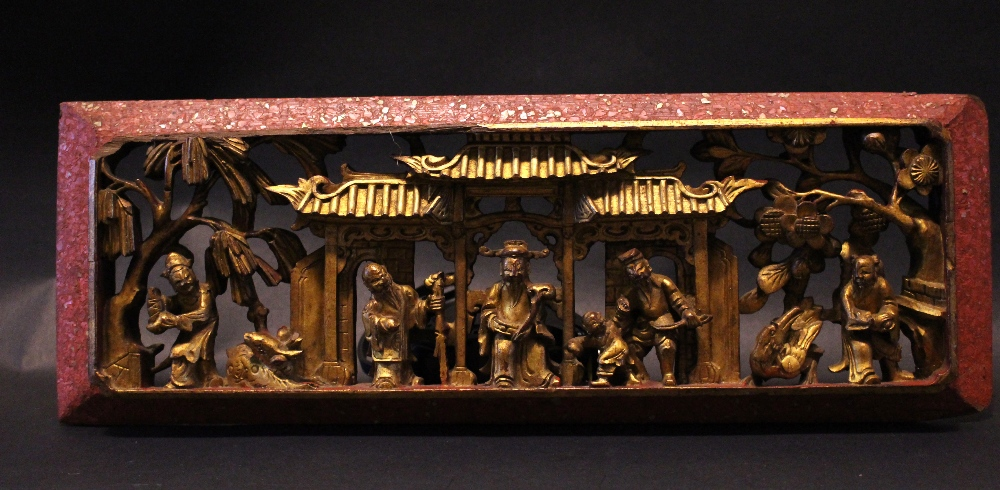 "Lot 12 - A GILTWOOD CARVED ORIENTAL SCENE, depicting figures, animals & florals 14.79"" x 5.25"" approx"