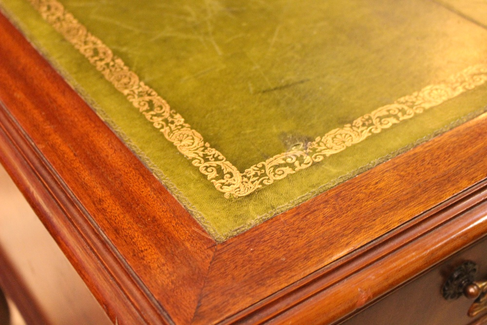Lot 48 - A LARGE LEATHER TOPPED WRITING DESK, with 5 drawers, raised on a Queen Anne leg, with pad foot,