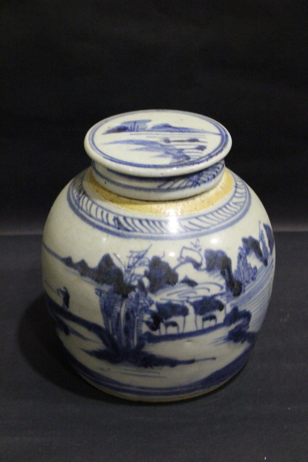 Lot 58 - A BLUE & WHITE GINGER JAR, with lid, images of a figure standing by water, with a landscape, in
