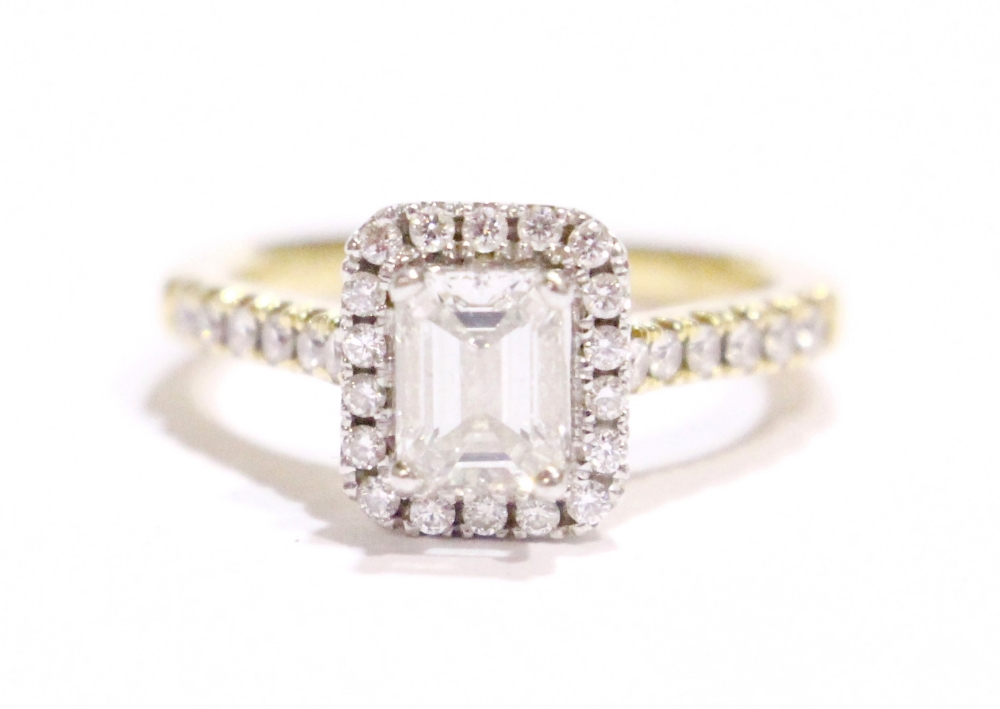 Lot 37 - A STUNNING 18CT YELLOW GOLD EMERALD CUT HALO DIAMOND RING, with central emerald cut diamond
