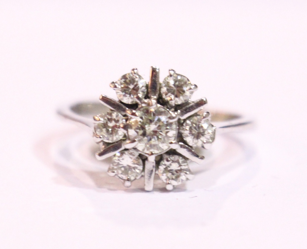 Lot 41 - AN 18CT WHITE GOLD 7 STONE DIAMOND CLUSTER RING, 1.50cts diamonds