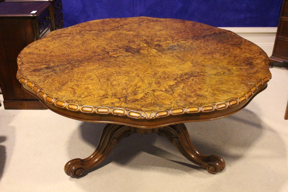 Lot 29 - A VERY FINE 19TH CENTURY BURR WALNUT CENTRE / DINING 'FLIP TOP' TABLE, with gadrooned rim, raised on