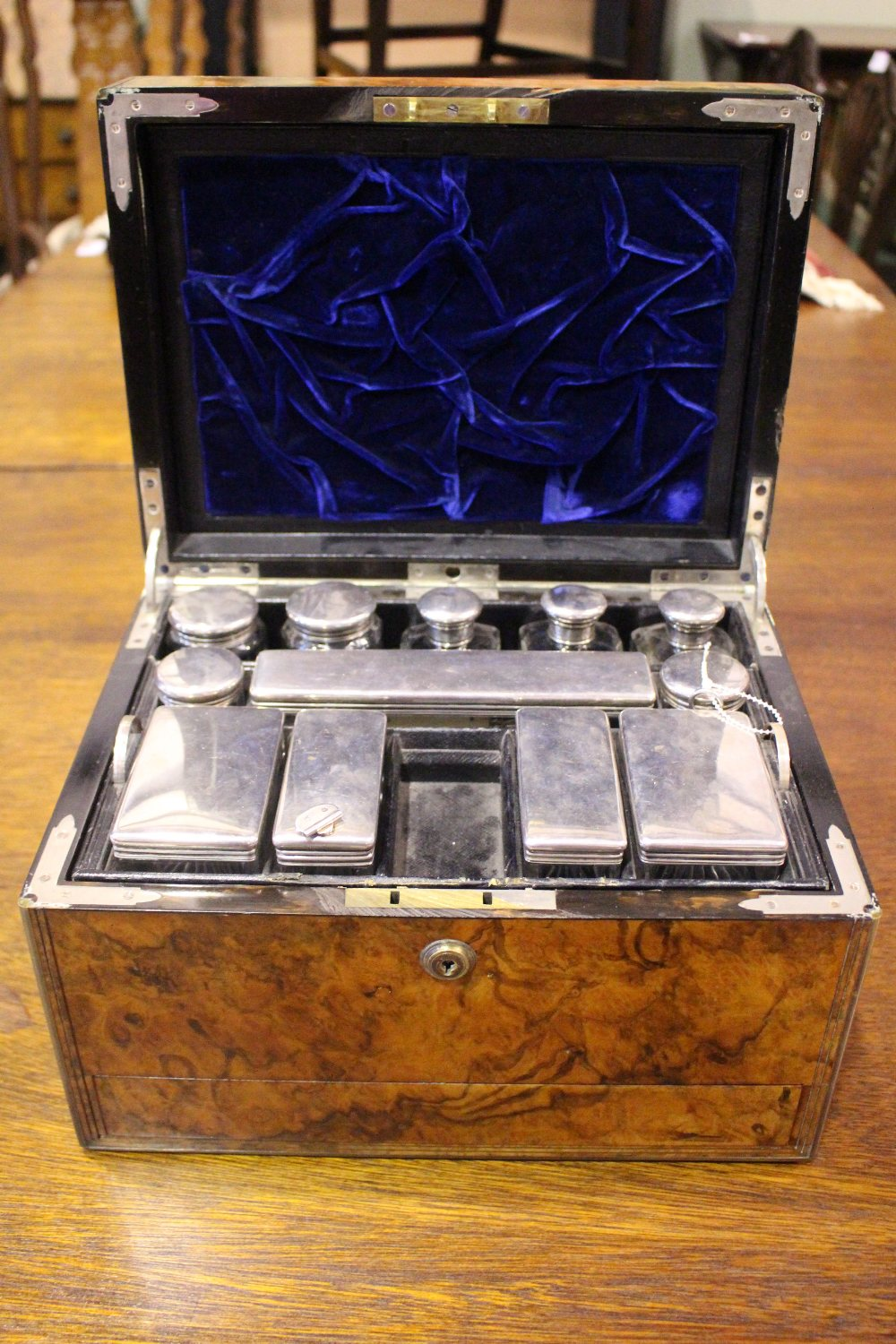 Lot 38 - A VERY FINE 19TH CENTURY BURR WALNUT LADIES TRAVELLING VANIETY BOX, with silver topped dressing
