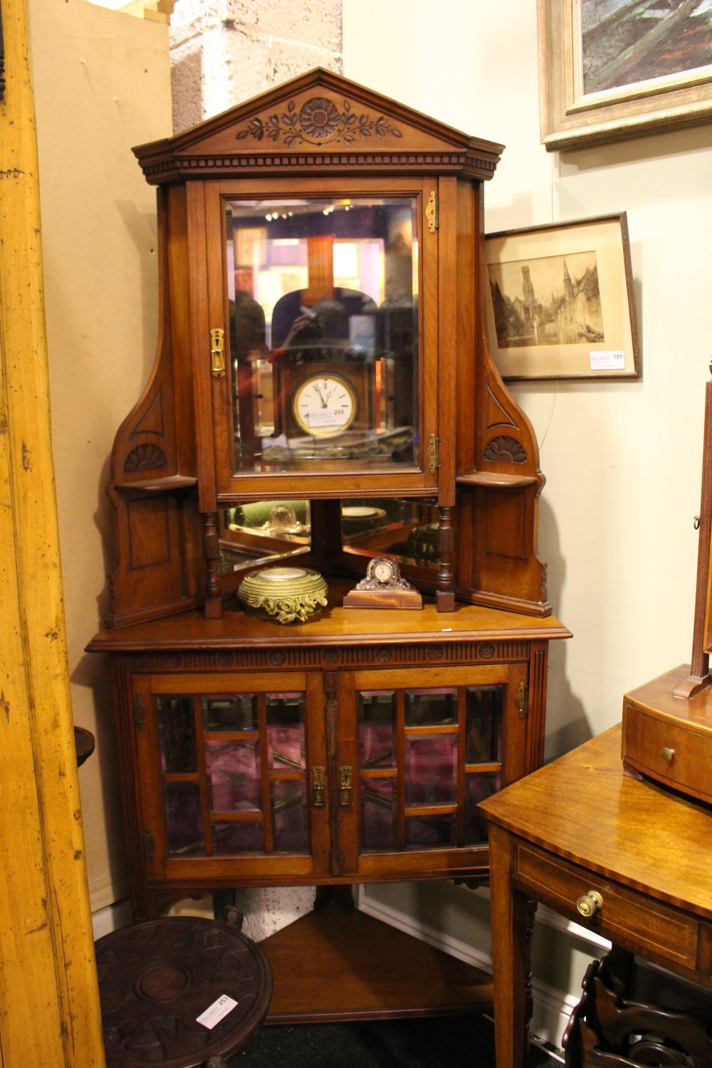 Lot 43 - A VERY FINE EARLY 20TH CENTURY WALNUT CORNER CABINET, with bevelled glazed cabinet over 2 door