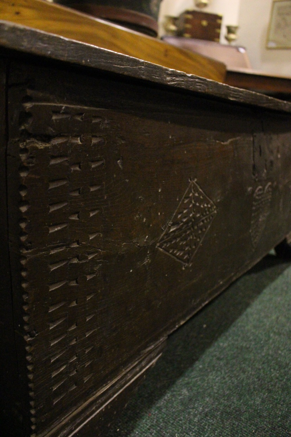 Lot 51 - AN OAK COFFER CHEST / MARRIAGE CHEST, with carved initials to the front and a love heart motif to
