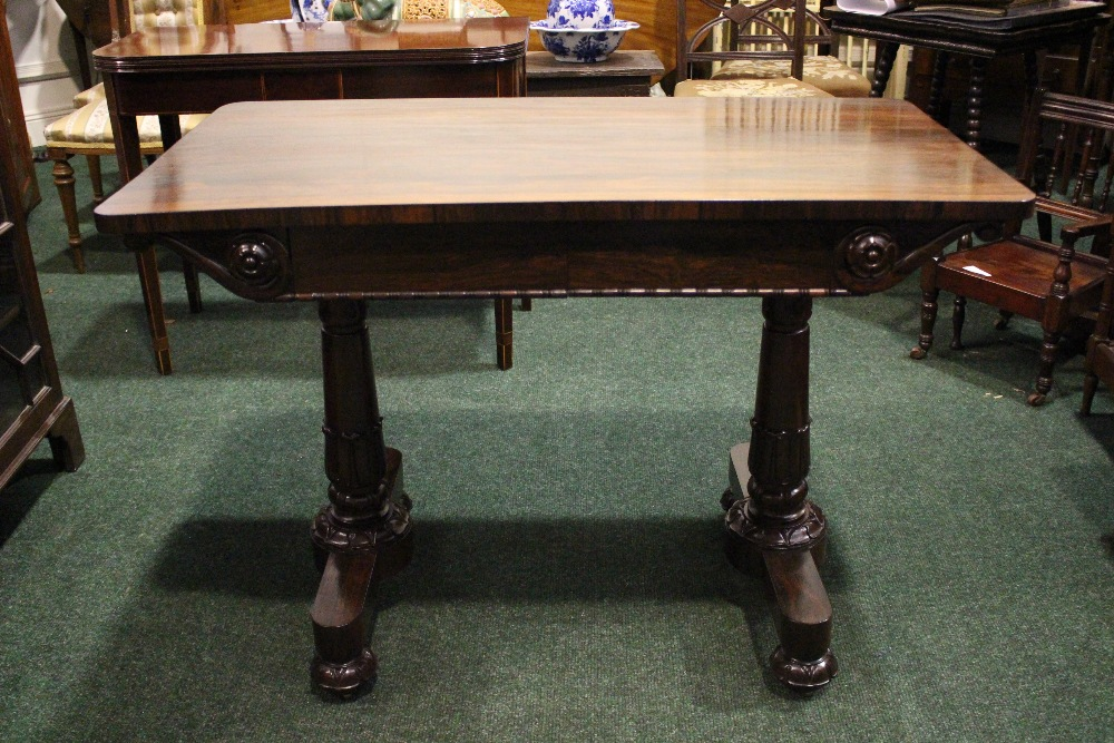 Lot 20 - A GOOD QUALITY ROSEWOOD WILLIAM IV LIBRARY TABLE, neat size, with 2 frieze drawers, having carved