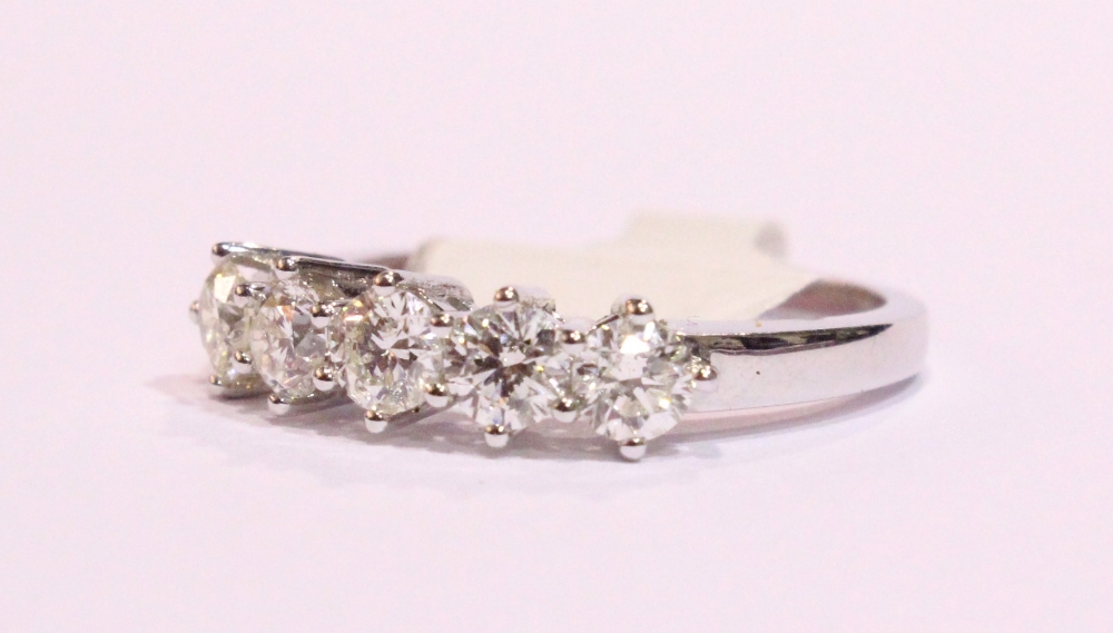 Lot 48 - AN 18CT WHITE GOLD 5 STONE DIAMOND RING, 1.35cts