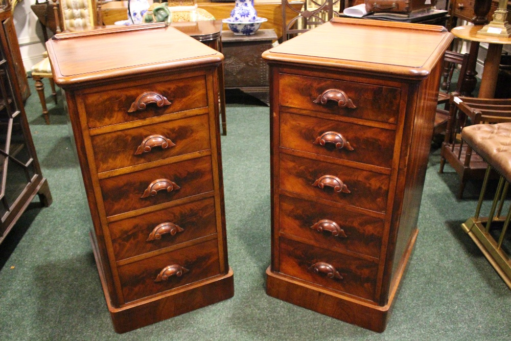 Lot 59 - A PAIR OF VICTORIAN 5 DRAWER CHESTS, with carved pull handles, on platform base, graduated