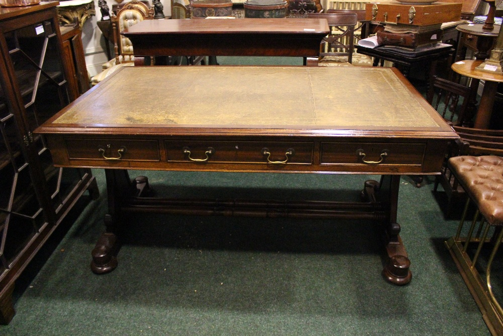 Lot 49 - A VERY FINE WILLIAM IV STYLE WRITING DESK / TABLE, with three frieze drawers having brass handles, a
