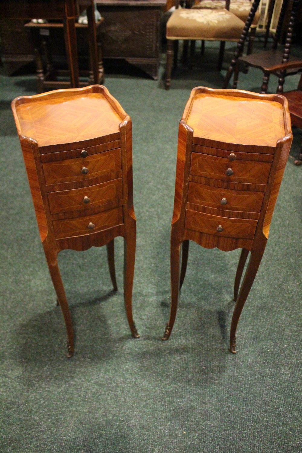 Lot 31 - A PAIR OF NEATLY SIZED KINGWOOD CROSSBANDED CHESTS, with 3 drawers to each, and a leather topped