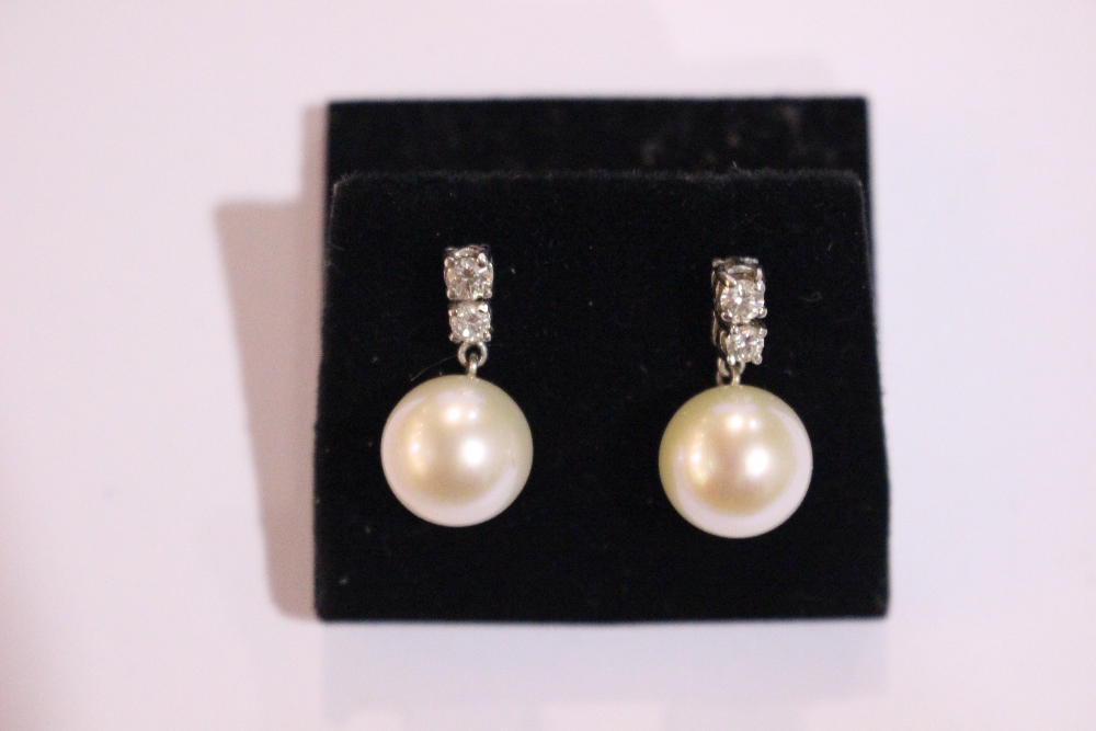 Lot 40 - A PAIR OF 18CT WHITE GOLD CULTURED PEARL & DIAMOND DROP EARRINGS