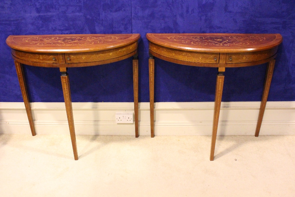 Lot 45 - A VERY FINE PAIR OF LATE 19TH CENTURY CROSSBANDED ROSEWOOD DEMI LUNE CONSOLE TABLES, each with a