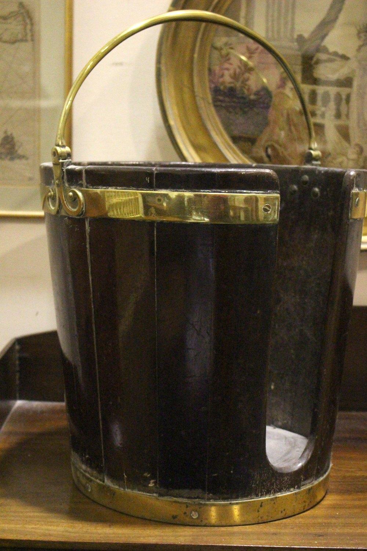 "Lot 53 - AN IRISH BRASS BOUND 'PLATE' BUCKET, with brass handle, 15.5"" tall, 15"" wide approx"