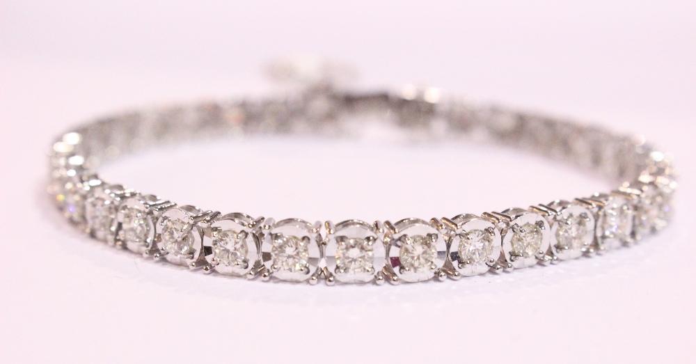 Lot 11 - A STUNNING 18CT WHITE GOLD DIAMOND TENNIS BRACELET, 5.88cts diamonds