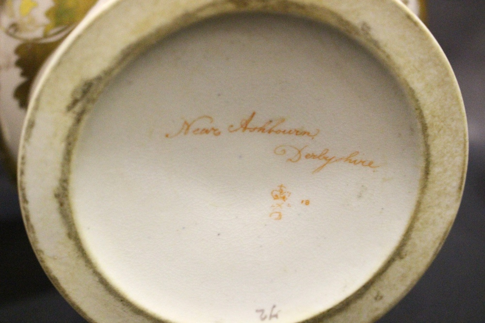 Lot 54 - A CROWN DERBY THREE PART GARNITURE, with a large central urn having a painted landscape image of